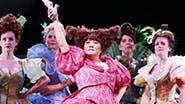 Ann Harada and the ladies' ensemble in Cinderella.