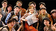 Kara Lindsay and the newsboys in Newsies.