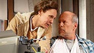 Laurie Metcalf as Annie Wilkes and Bruce Willis as Paul Sheldon in Misery.