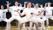 Rory O'Malley and the company of The Book of Mormon.
